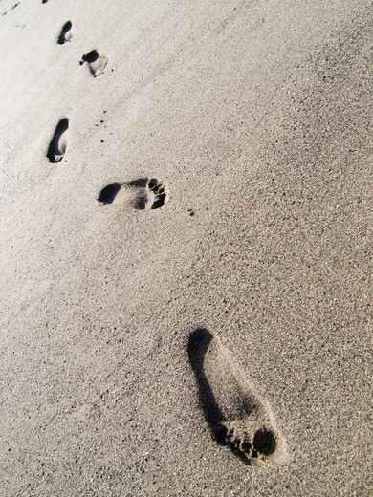 Stock Photo: 4292-99833 Footprints on sand