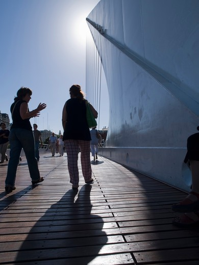 Stock Photo: 4292-99959 People walk on Santiago Calatrava's Puente De La Mujer (Bridge Of The Woman) in Buenos Aires, Argentina