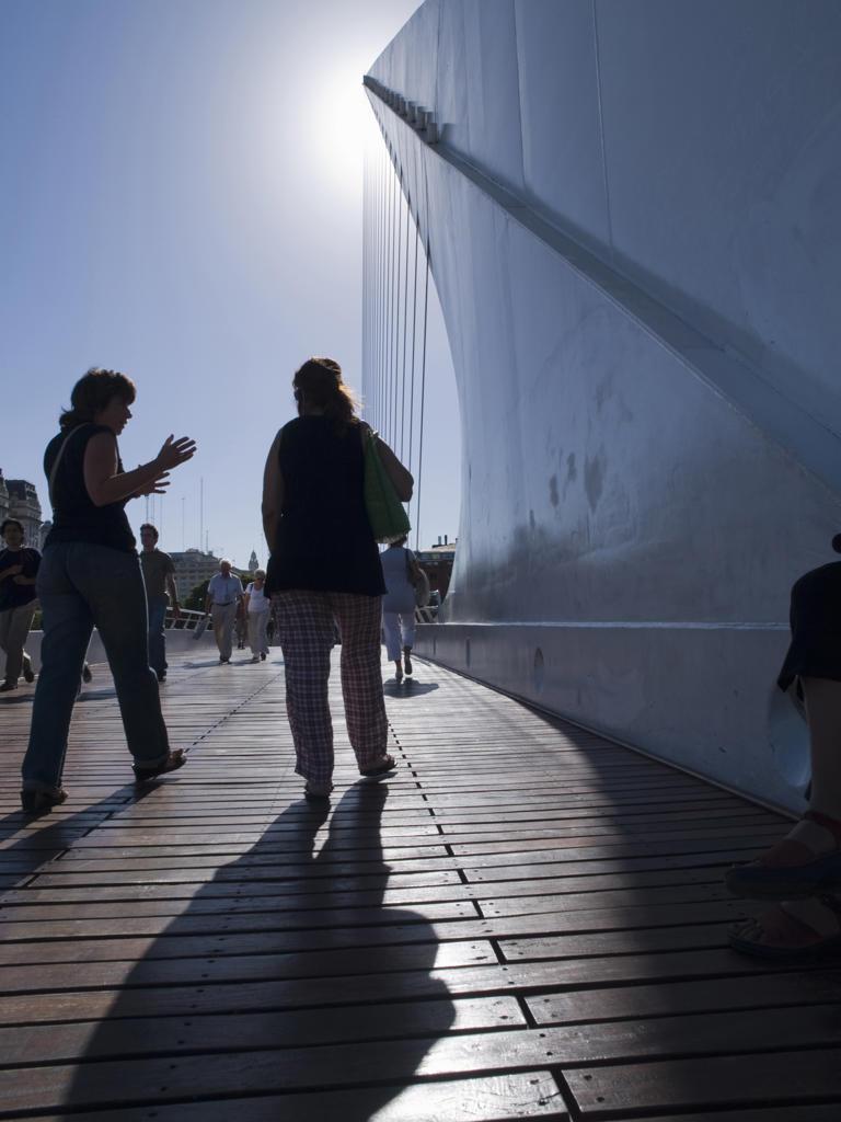 People walk on Santiago Calatrava's Puente De La Mujer (Bridge Of The Woman) in Buenos Aires, Argentina : Stock Photo