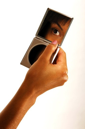 Stock Photo: 4292R-150954 Woman's eye reflected in a mirror