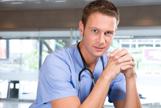 Stock Photo: 4294R-1446 Young smiling doctor in hospital