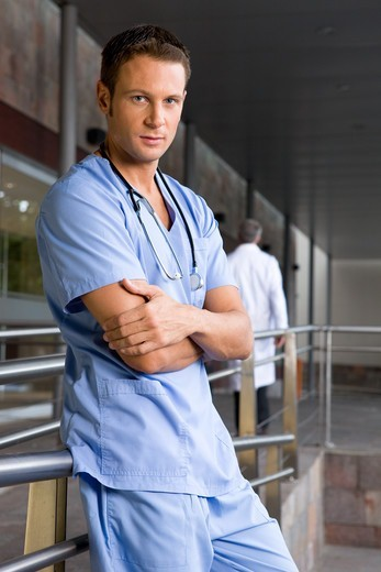 Young doctor with arms crossed : Stock Photo