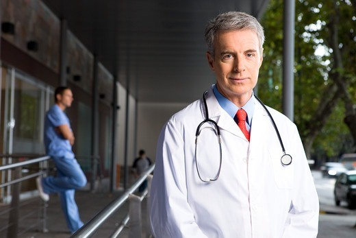 Doctor outside hospital : Stock Photo