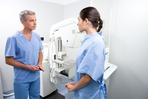 Stock Photo: 4294R-1484 Doctor and patient performing a mammography
