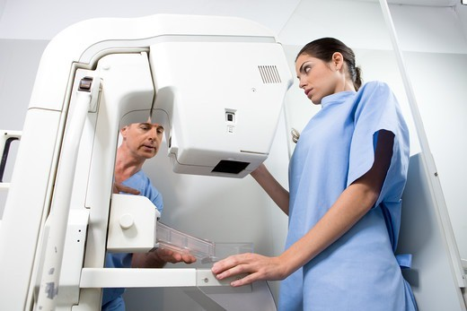 Doctor and patient performing a mammography : Stock Photo