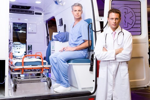 Two paramedics with an ambulance car : Stock Photo
