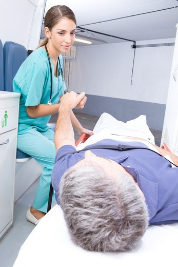 Stock Photo: 4294R-1503 Nurse caring after patient