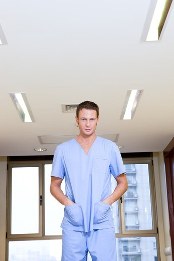 Stock Photo: 4294R-1513 Male nurse on hospital corridor