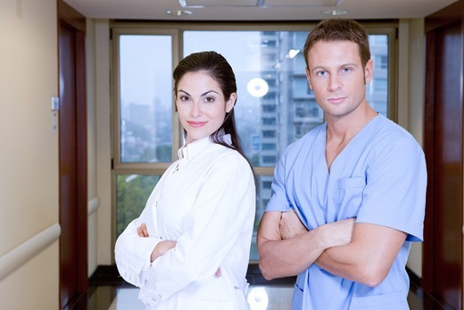 Stock Photo: 4294R-1528 Two doctors with arms crossed