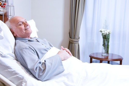 Senior man in hospital bed : Stock Photo