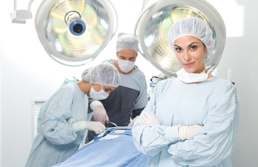 Confident surgeon in operating room : Stock Photo