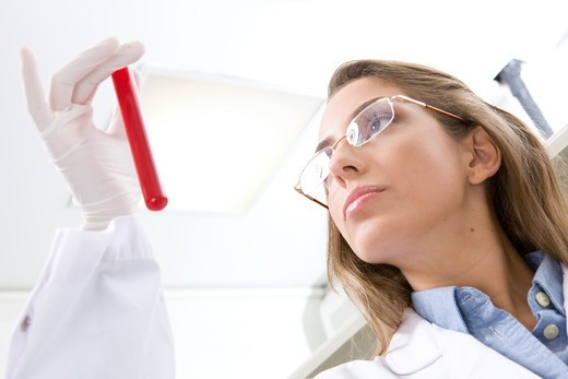Stock Photo: 4294R-1563 Hospital technician analyzing blood sample
