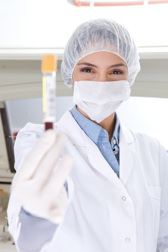 Stock Photo: 4294R-1566 Hospital technician holding blood sample