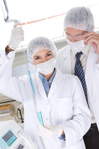 Stock Photo: 4294R-1567 Two medical scientists at work