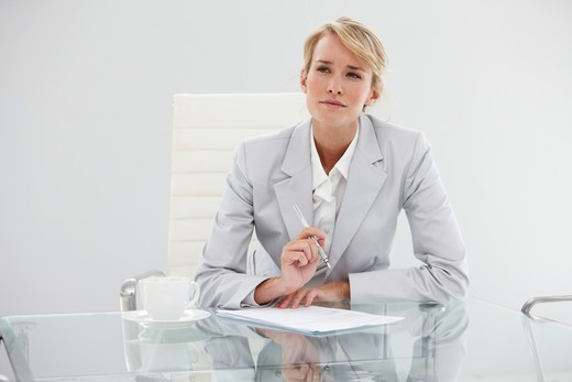 Stock Photo: 4294R-1668 Businesswoman working at desk