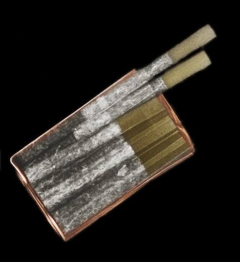 Colorized x-ray of a pack of filter cigarettes : Stock Photo
