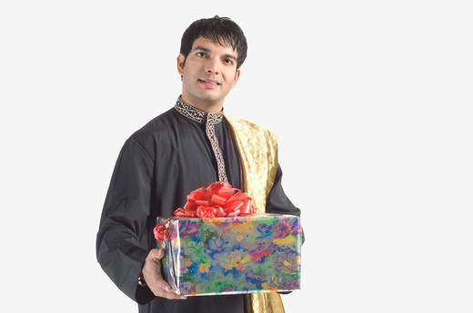 Stock Photo: 4303R-1535 Young man holding gift, portrait