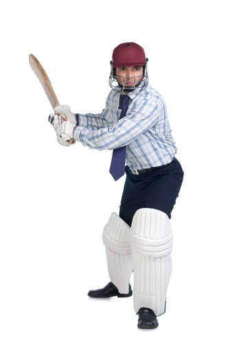 Stock Photo: 4303R-1568 Businessman holding bat