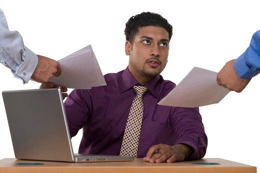 Stock Photo: 4303R-1658 Businessman with laptop taking documents