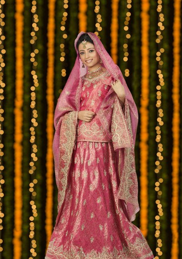 Stock Photo: 4303R-3007 Full body shot of an indian bride