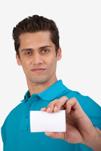 Man holding a small blank card. : Stock Photo
