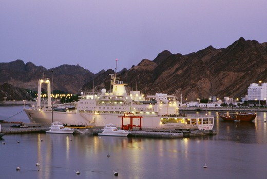 Stock Photo: 4304R-1495 A ship is anchored at the dock at dusk.