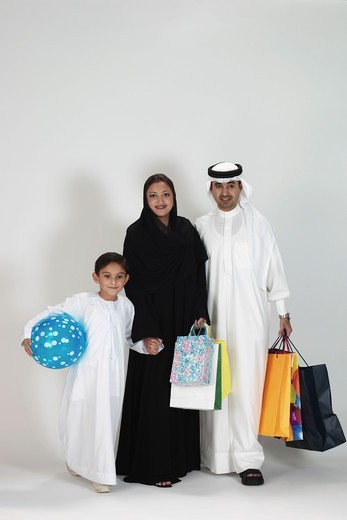 Arab Family with a shopping bag : Stock Photo