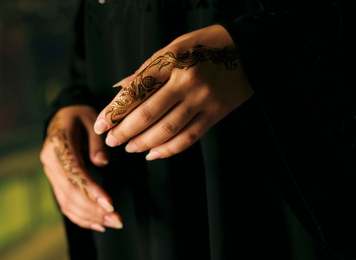 Hands with henna : Stock Photo