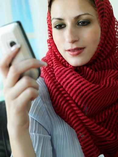 Arab lady on the phone : Stock Photo