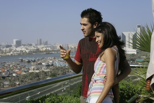 Stock Photo: 4304R-2518 Young couple looking away.