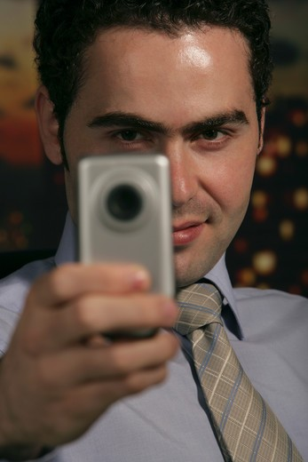 Stock Photo: 4304R-2794 Businessman with phone camera