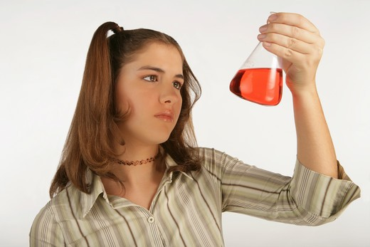 Young girl mix the chemicals in the laboratory. : Stock Photo