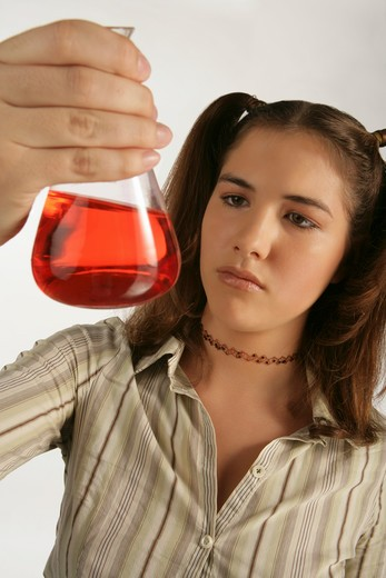 Stock Photo: 4304R-2861 Young girl mix the chemicals in the laboratory.