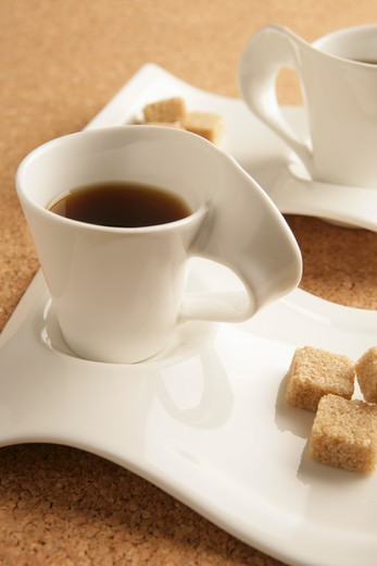 Stock Photo: 4304R-3102 Cups of coffee and sugar.