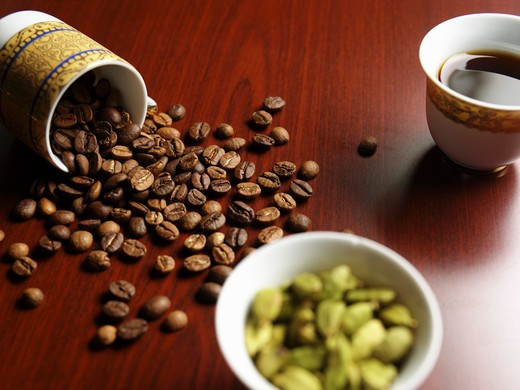 Stock Photo: 4304R-3111 Cup of coffee and beans on a table.