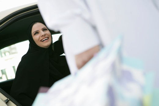 Arab lady inside the car : Stock Photo