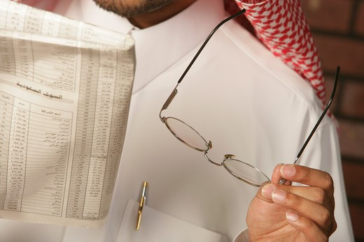 Arab Man reading the newspaper : Stock Photo