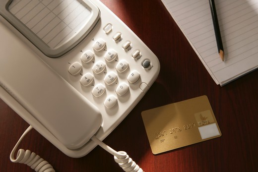 Stock Photo: 4304R-3733 Credit Card and a telephone