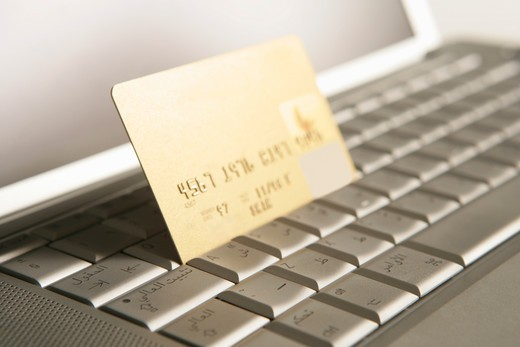Stock Photo: 4304R-3781 Credit card on a laptop