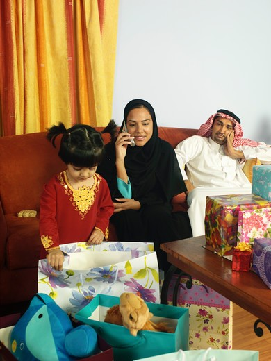Arab family in a living room : Stock Photo
