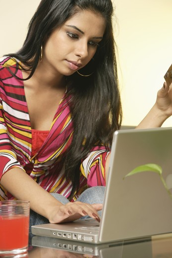 Lady busy in online transaction : Stock Photo