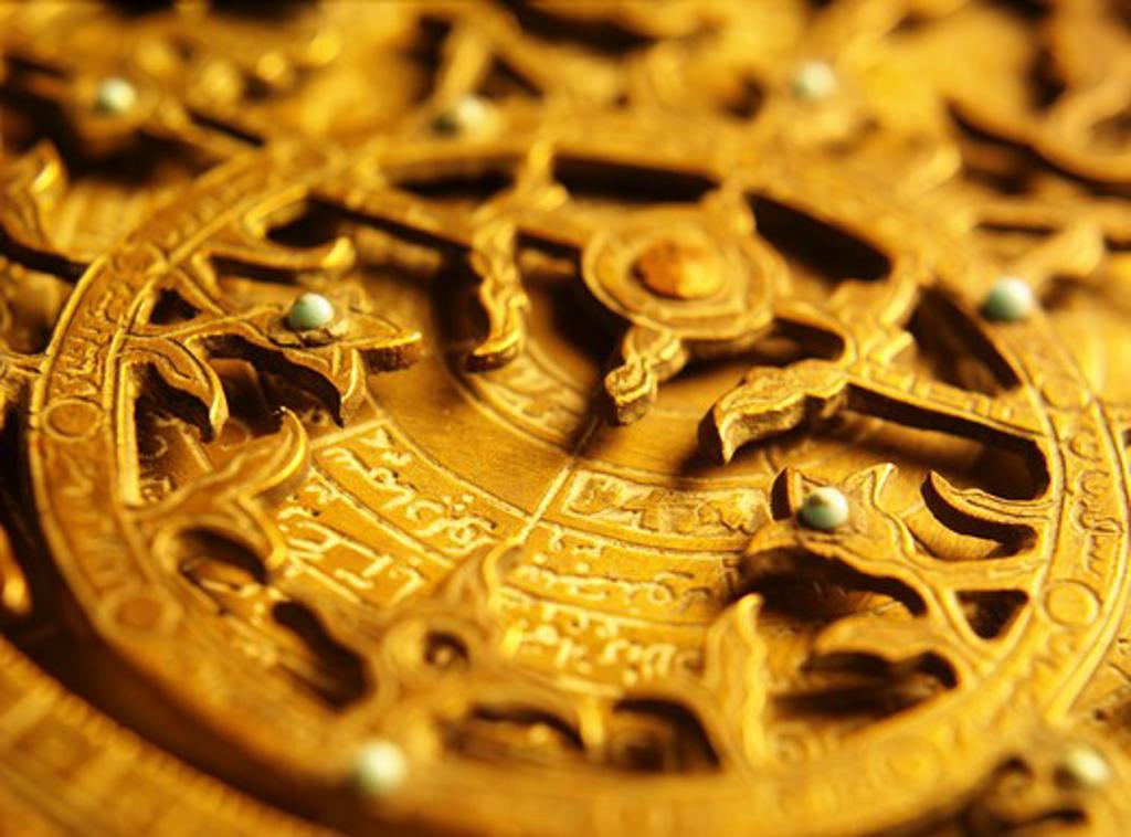 Brass object with Arabic script : Stock Photo