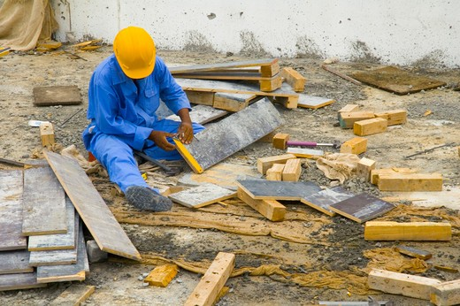 View of the construction workers busy on their work. : Stock Photo