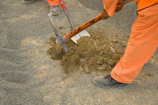 Stock Photo: 4304R-4276 Man digging the ground