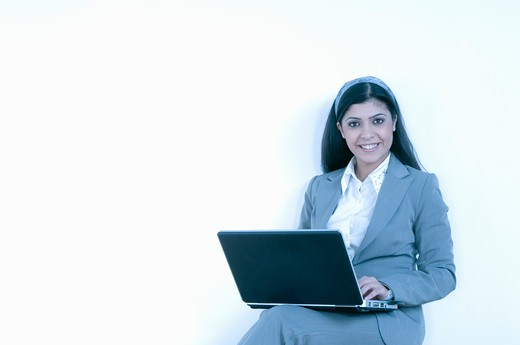 Stock Photo: 4304R-4475 Lady with computer