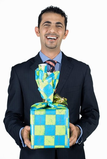 Stock Photo: 4304R-4720 Businessman holding present