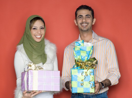 Stock Photo: 4304R-4774 Couple holding presents