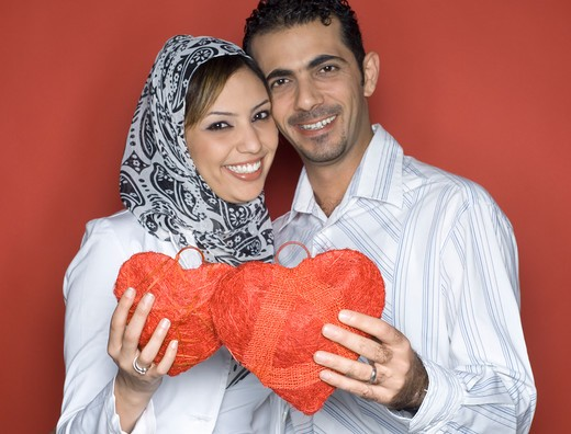 Stock Photo: 4304R-4782 Young Couple holding heart shaped object
