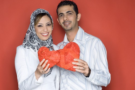 Stock Photo: 4304R-4785 Young Couple holding heart shaped object