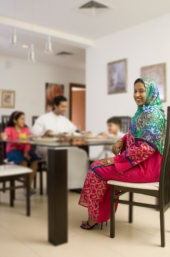 Stock Photo: 4304R-4880 Arab Family of four dining while woman smiles